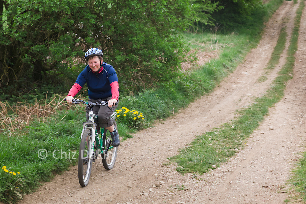 Exhilaration and smiles on Andrea's face as she conquers a steep downhill on her first cycle trip off-road!