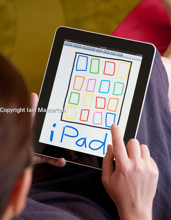 Woman drawing an iPad using sketch application on an iPad tablet computer