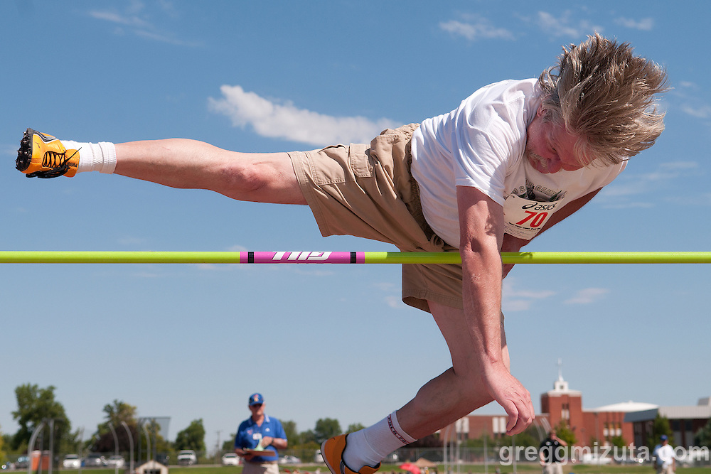 """Rod Soper utilizes the straddle technique as he high jumps during the 2011 Idaho Senior Games track & field meet at Northwest Nazarene University in Nampa, ID on August 20, 2011. Soper placed second in the mens 50-54 high jump with a height of 4'03.75"""" (1.32m)."""