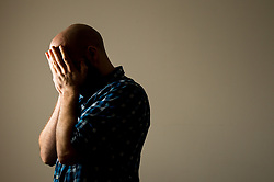 Embargoed to 0001 Thursday June 1 PICTURE POSED BY MODEL File photo dated 09/03/15 of a man with his head in his hands. Almost half of public sector workers have been forced to take time off work because of problems with their mental health, a large new survey has found.