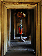 A Standing Buddha image in the western entrance towers gallery of Angkor Wat.