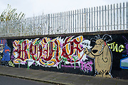 Street art graffiti of Hanna Barbera cartoon characters Dastardly and Muttley in Birmingham, United Kingdom. Villainous Dick Dastardly and his snickering canine sidekick, Muttley, take their destructive antics from the roads to the skies in this spinoff of the cartoon 'Wacky Races.'