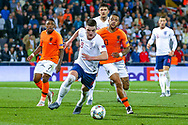 England midfielder Declan Rice (West Ham) takes the ball from Netherlands forward Memphis Depay (Lyon) during the UEFA Nations League semi-final match between Netherlands and England at Estadio D. Afonso Henriques, Guimaraes, Portugal on 6 June 2019.