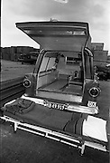 """25/06/1963<br /> 06/25/1963<br /> 25 June 1963<br /> Ford station wagon Ambulance being unloaded from the ship the """"City of Cork"""" at the North Wall, Dublin port. Image shows rear door of the ambulance opened with the stretcher deployed from the vehicle."""