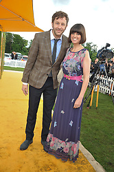CHRIS O'DOWD and DAWN PORTER at the 2012 Veuve Clicquot Gold Cup Final at Cowdray Park, Midhurst, West Sussex on 15th July 2012.
