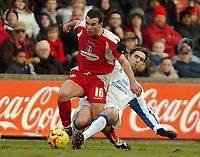 Photo: Ed Godden.<br />Leyton Orient v Carlisle United. Coca Cola League 2. 11/02/2006.<br />Leyton Orient's Shaun Tudor (L) is badly tackled by Zigor Aranalde.