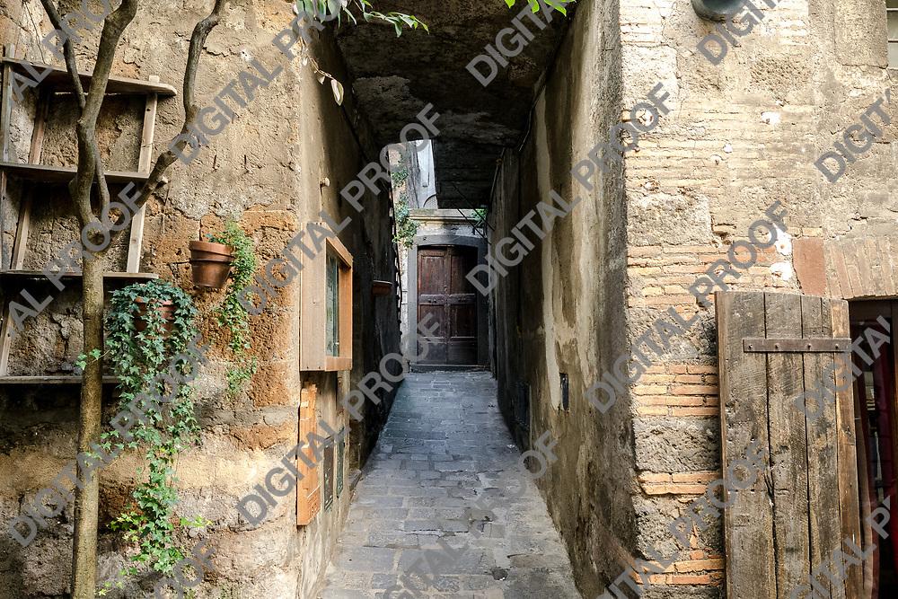 Orvieto cobble street empty at mid day.  Italy, 2017.