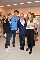 Left to right, FRANCESCA MOUFARRIGE, TIM MOUFARRIGE, TOUKER SULEYMAN and NATASHA MOUFARRIGE at a party to celebrate the re-launch of the Ghost Flagship store at 120 King's Road, London on 15th April 2015.