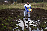 A participant stands and practices in the mud at the 2011 Mud Volleyball Tournament in Laclede, ID sponsored by the Kodiak Bar. .(©Matt Mills McKnight/2011)