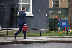 © licensed to London News Pictures. London, UK 20/03/2013. Chancellor of the Exchequer George Osborne leaving after posing for photographers outside 11 Downing Street before presenting his annual budget to Parliament on Wednesday 20 March 2013 in London.  George Osborne poses for photographers outside 11 Downing Street before presenting his annual budget to Parliament on Wednesday 20 March 2013 in London. Photo credit: Tolga Akmen/LNP