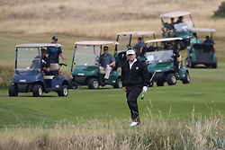 US President Donald Trump plays a round of golf with his son Eric Trump (left) on the Trump Turnberry resort in South Ayrshire, where he and first lady Melania Trump are spending the weekend.