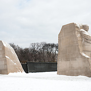 Snow covers the Martin Luther King Jr Memorial on the banks of the Tidal Basin after a winter snow storm hits Washington DC.