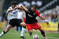 Photo: Rich Eaton.<br /> <br /> Derby County v Southampton. Coca Cola Championship.<br /> <br /> 06/08/2006. Derbys Marc Edworthy (left) tackles Southamptons Rudi Skacel (right)