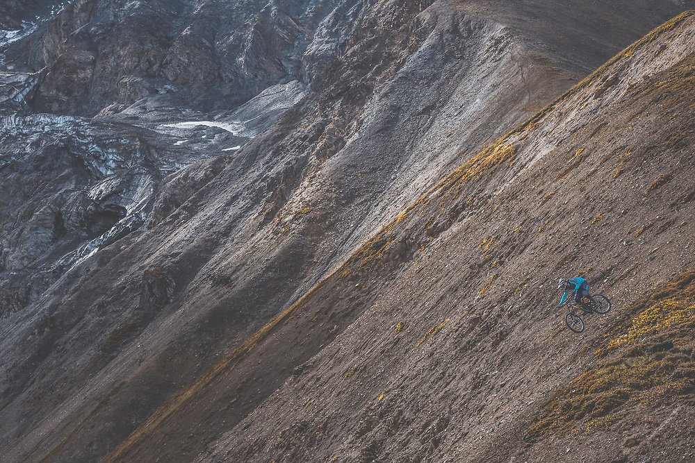 Wade Simmons rides down a previously untouched slope in the Tatshenshini-Alsek Provincial Park in British Columbia, Canada on September 3, 2016.