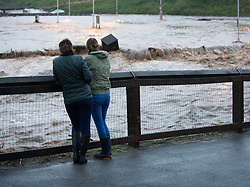© Licensed to London News Pictures. 06/09/2013<br /> <br /> Saltburn, Cleveland, England<br /> <br /> As darkness falls two women look on as heavy flooding tears through Saltburn in Cleveland.<br /> <br /> Photo credit : Ian Forsyth/LNP