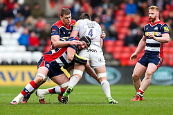 Elliott Stooke of Bath Rugby is tackled by Dan Tuohy and Ian Evans of Bristol Rugby - Rogan Thomson/JMP - 26/02/2017 - RUGBY UNION - Ashton Gate Stadium - Bristol, England - Bristol Rugby v Bath - Aviva Premiership.