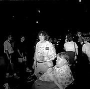 Elvis Presley fans wait outside Graceland.