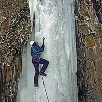 "ICE CLIMBING. Geoff Heath on ""Elevator Shaft"", Hyalite Canyon, Gallatin Mountains, near Bozeman, MT.  Gallatin National Forest."
