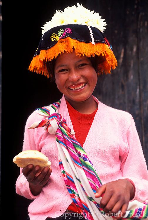 PERU, HIGHLANDS, MARKETS Pisac; Quechua girl selling bread