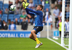 """Brighton & Hove Albion goalkeeper Mathew Ryan warms up prior to the Premier League match at the AMEX Stadium, Brighton. PRESS ASSOCIATION Photo. Picture date: Sunday August 19, 2018. See PA story SOCCER Brighton. Photo credit should read: Gareth Fuller/PA Wire. RESTRICTIONS: EDITORIAL USE ONLY No use with unauthorised audio, video, data, fixture lists, club/league logos or """"live"""" services. Online in-match use limited to 120 images, no video emulation. No use in betting, games or single club/league/player publications."""