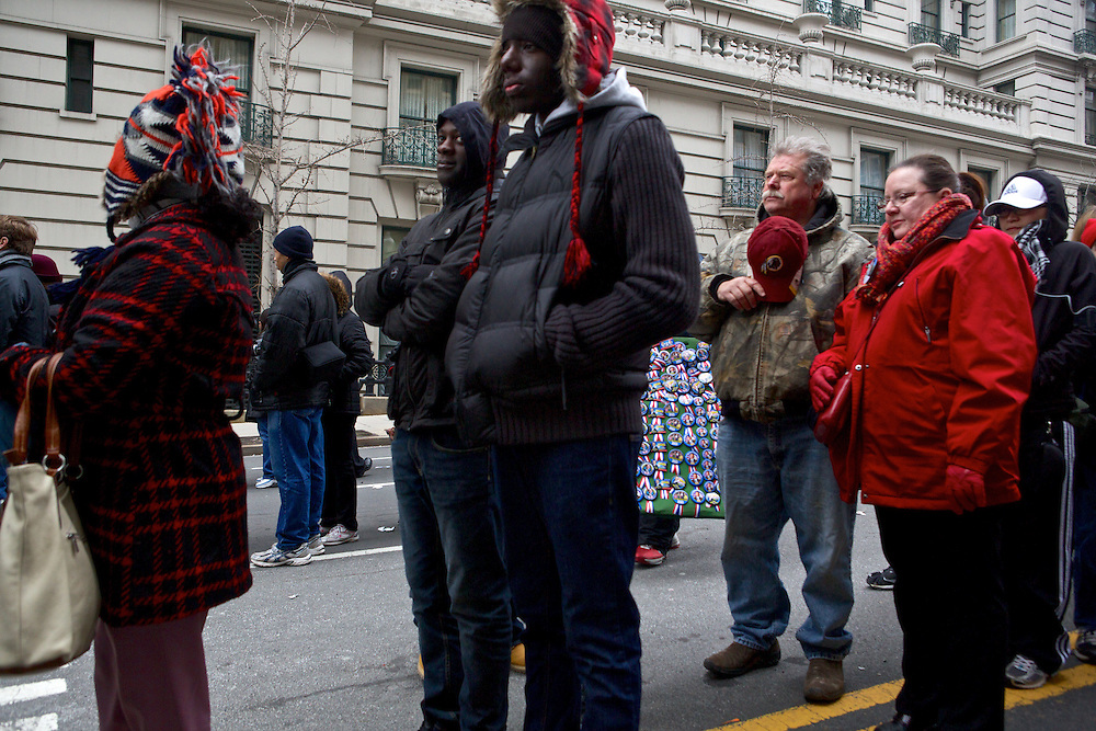 Attendees of the Inaugrual ceremonies for Pres. Barack Obama stand for the National Anthem while in line to get in to the parade route January 21, 2013 in Washington, D.C.