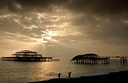 Brighton seafront at sunset with the collapsed pier in the backgound