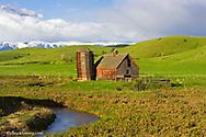 Willow Creek Barn with the Beartooth Mountains near Cooney, Montana, USA