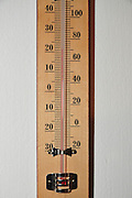 household Thermometer with both Celsius and Fahrenheit scales showing a pleasant room temperature of 21 degrees C or 70 Degrees F on white background