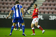 Wigan Athletic defender Scott Wootton (14) and Charlton Athletic forward Conor Washington (14) during the EFL Sky Bet League 1 match between Wigan Athletic and Charlton Athletic at the DW Stadium, Wigan, England on 2 March 2021.