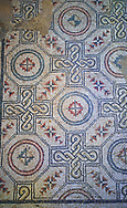 Close up picture of the Roman mosaics of the Kitchen floor depicting geometric mosaic patterns, room no 19 at the Villa Romana del Casale, first quarter of the 4th century AD. Sicily, Italy. A UNESCO World Heritage Site. .<br /> <br /> If you prefer to buy from our ALAMY PHOTO LIBRARY  Collection visit : https://www.alamy.com/portfolio/paul-williams-funkystock/villaromanadelcasale.html<br /> Visit our ROMAN MOSAICS  PHOTO COLLECTIONS for more photos to buy as buy as wall art prints https://funkystock.photoshelter.com/gallery/Roman-Mosaics-Roman-Mosaic-Pictures-Photos-and-Images-Fotos/G00008dLtP71H_yc/C0000q_tZnliJD08