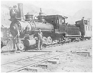 """RGS 4-6-0 #2 with caboose W400 in Telluride yard.<br /> RGS  Telluride, CO  ca. 1903<br /> In book """"RGS Story, The Vol. XII: Locomotives and Rolling Stock"""" page 14<br /> Also in """"RGS Story Vol. II"""", p. 97; """"RGS Railroad"""", p. 318 and """"RGS Story"""", p. 78."""