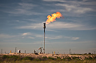 Flare and a fracking industry site in Wolfslair Shale outside of Big Spring Texas