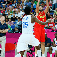 08 August 2012: Spain Juan-Carlos Navarro takes a three points jumpshot during 66-59 Team Spain victory over Team France, during the men's basketball quarter-finals, at the 02 Arena, in London, Great Britain.