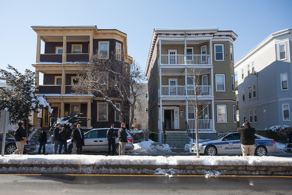 Boston, MA 02/07/2014<br /> A Boston Police Department photographer photographs the home at 617 Morton St where a 9 year old boy was killed in an accidental shooting on Friday.<br /> Alex Jones / www.alexjonesphoto.com