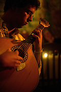 """Player of Portuguese Guitar performing at restaurant """"Mesa de Frades"""", an old chapel in Alfama typical neighborhood. Portuguese Guitar, the main instrument used in fado music. It's believed that this twelve-chord instrument is an evolution from arabic citar."""