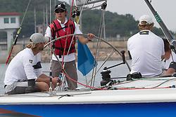 Zhang Lizhong from Qingdao gets a turn on the helm while skipper Bjorn Hansen takes a break. Korea Match Cup 2010. World Match Racing Tour. Gyeonggi, Korea. 11 June 2010. Photo: Gareth Cooke/Subzero Images