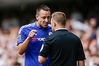 Chelsea's John Terry argues with the assistant referee over the tackle that got Chelsea's Thibaut Courtois sent off<br /> <br /> Photographer Craig Mercer/CameraSport<br /> <br /> Football - Barclays Premiership - Chelsea v Swansea City - Saturday 8th August 2015 - Stamford Bridge - London<br /> <br /> © CameraSport - 43 Linden Ave. Countesthorpe. Leicester. England. LE8 5PG - Tel: +44 (0) 116 277 4147 - admin@camerasport.com - www.camerasport.com