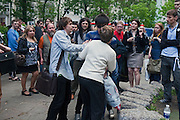 Moscow, Russia, 12/05/2012..Protesters seize a man attempting to steal a mobile phone from a woman  in the crowd in Chistiye Prudy, or Clean Ponds, a park in central Moscow were some 200 opposition activists have set up camp.