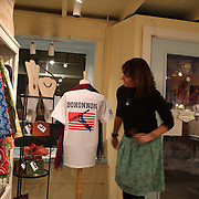 Andrea Panullo with a t-shirt supporting Olympic Freestyle Aerial Skier Mac Bohonnon on display in bella Perlina, Madison, Connecticut, USA. 20th February 2014. Photo Tim Clayton
