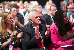 @Licensed to London News Pictures 21/09/2019. Brighton. Shadow Chancellor of the Exchequer John McDonnell applauds the speakers as the Labour Party takes its place on the stage for the opening day of the Labour Party Conference in Brighton. The conference will continue over the next 5 days. Photo credit: Manu Palomeque/LNP