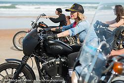 Leticia Cline riding on Daytona Beach during Daytona Bike Week 75th Anniversary event. FL, USA. Thursday March 3, 2016.  Photography ©2016 Michael Lichter.