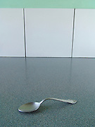 Bent spoon on counter.