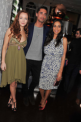 Left to right, OLIVIA GRANT, HUGO TAYLOR, ROSARIO DAWSON at the opening of the 'pop up' Tanqueray Gin Palace hosted by Idris Elba at 13 Floral Street, Covent Garden, London on 26th March 2013.