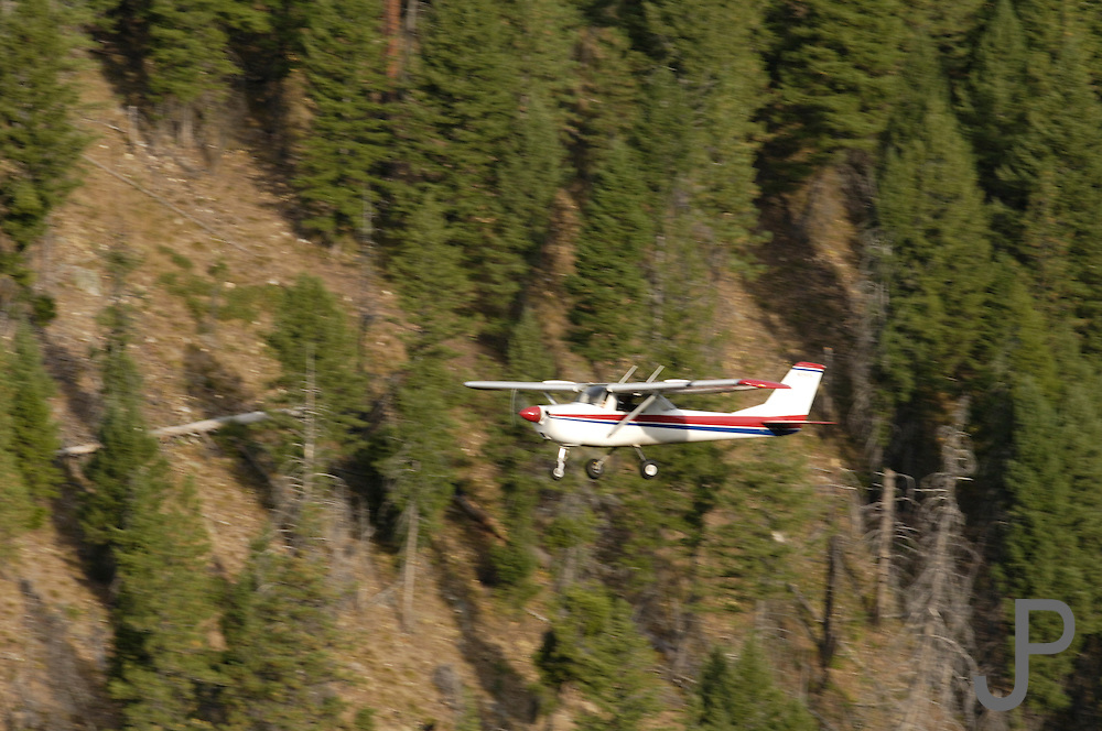 Cessna 172 flying in the Idahow wilderness outside McCall, ID