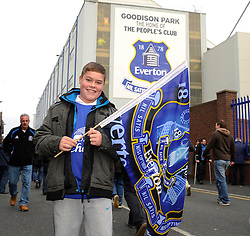 An Everton FC fan outside Goodison Park - Photo mandatory by-line: Dougie Allward/JMP - Tel: Mobile: 07966 386802 23/11/2013 - SPORT - Football - Liverpool - Merseyside derby - Goodison Park - Everton v Liverpool - Barclays Premier League