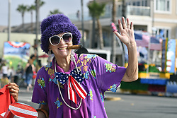 July 4, 2017 - Huntington Beach, California, USA - Aunt Gertie (Karen Hadley) waves to the crowd before the start of the 113th annual Huntington Beach 4th of July Parade on Tuesday, July 4, 2017. (Credit Image: © Jeff Gritchen/The Orange County Register via ZUMA Wire)
