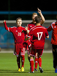 NEWPORT, WALES - Thursday, September 25, 2014: Wales' Brandon Burrows, Daniel Jefferies and Liam Cullen celebrate after the 2-1 victory over France during the Under-16's International Friendly match at Dragon Park. (Pic by David Rawcliffe/Propaganda)