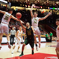 Deondre Begay (22) drives to the basket for the Newcomb Skyhawks while Xavier Padilla (30) and Anthony Armijo (14) defend for the Pecos Panthers in their 2019 New Mexico 2A Boys Championship game Saturday, March 16, at the Dreamstyle Arena in Albuquerque. Pecos beat Newcomb 58-37.