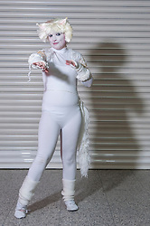 """© Licensed to London News Pictures. 14/03/2015. Newham, London, UK.  A man dressed as a character from the musical """"Cats"""", one of many cosplayers attending the London Comic Con at the Excel Centre in Docklands. Photo credit : Stephen Chung/LNP"""