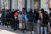 Shoppers queue to enter Nike Town on Oxford Street as non-essential shops reopen and the national coronavirus lockdown three eases on 12th April 2021 in London, United Kingdom. Now that the roadmap for coming out of the national lockdown has been laid out, this is the first phase of the easing of restrictions, and large numbers of people are out in Londons retail district to go shopping.